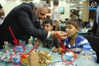 Hamas Prime Minister Ismail Haniyeh feeding Israeli yoghurt to a Gazan boy!